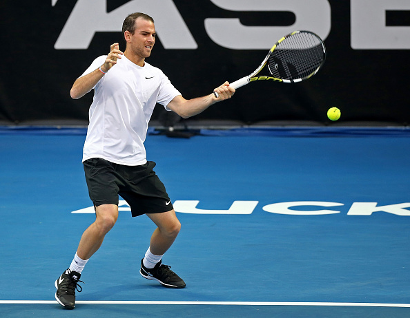 Adrian Mannarino strikes a forehand (Photo: Dave Rowland/Getty Images)