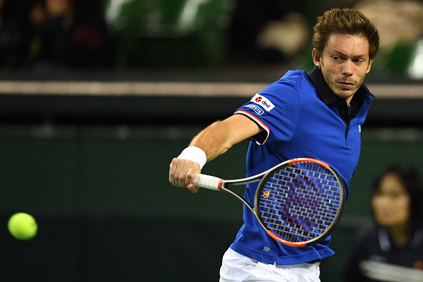 Nicolas Mahut strikes a backhand shot (Photo: Atsushi Tomura/Getty Images)