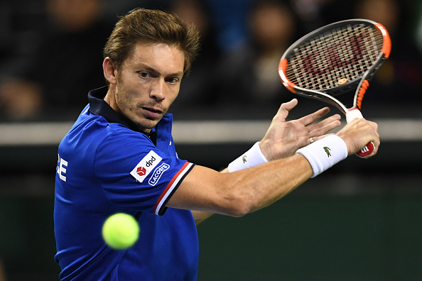Nicolas Mahut plays a return shot (Photo: Atsushi Tomura/Getty Images)