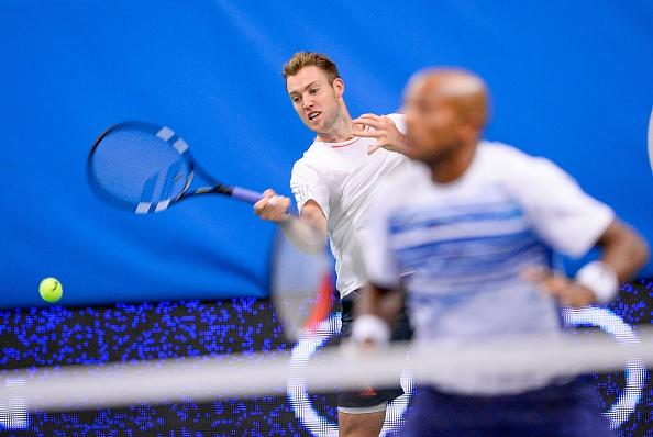 Jack Sock hits a forehand return with partner Nicholas Monroe on looking (Photo: Jonathan Nackstrand/Getty Images)