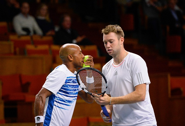 Nicholas Monroe and Jack Sock talk tactics in between points (Photo: Jonathan Nackstrand/Getty Images)