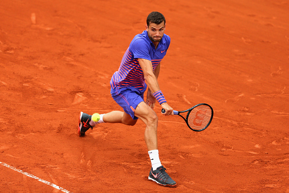 Grigor Dimitrov hitting a backhand shot (Photo: Clive Mason/Getty Images)