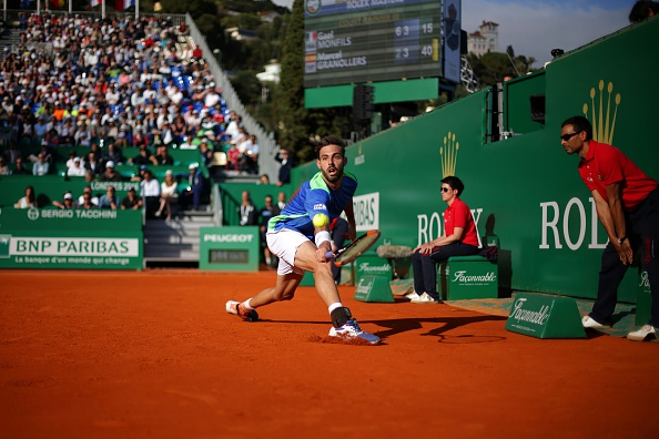 Marcel Granollers stretches for a shot (Photo: Jean Christophe Magnenet/Getty Images)