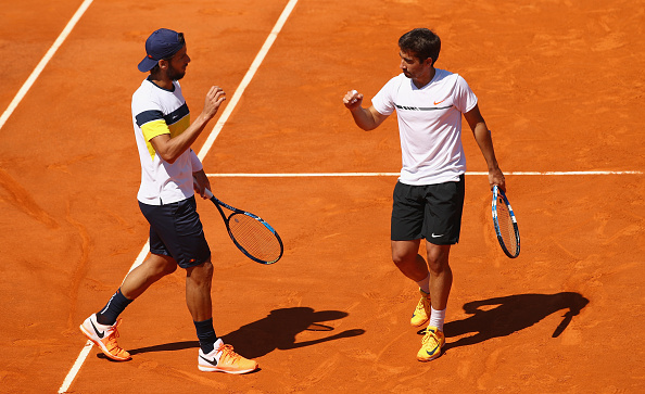 Feliciano Lopez and Marc Lopez react to winning a point (Photo: Clive Brunskill/Getty Images)