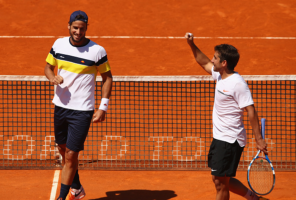 Feliciano Lopez and Marc Lopez celebrate to the crowd (Photo: Clive Brunskill/Getty Images)