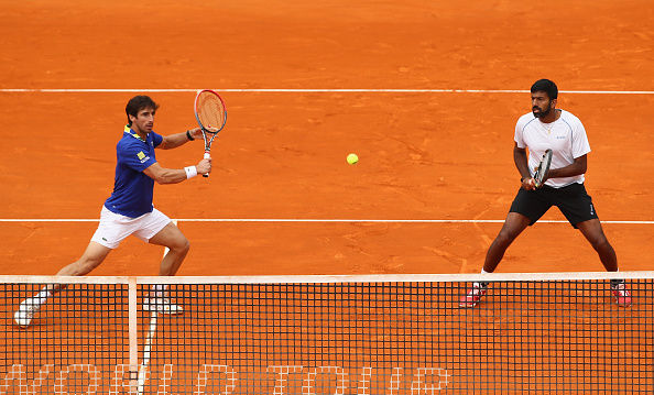 Pablo Cuevas gearing up to hit a volley with partner Rohan Bopanna looking on (Photo: Clive Brunskill/Getty Images)