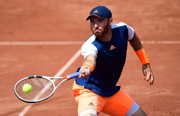 Bjorn Fratangelo hits a return to Gilles Simon (Photo: Attila Kisbenedek/Getty Images)