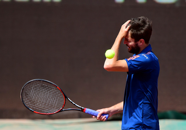 A frustrated Gilles Simon reacts after losing a point (Photo: Attila Kisbenedek/Getty Images)
