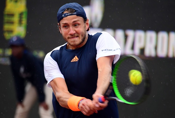 Lucas Pouille strikes a forehand shot (Photo: Atilla Kisbenedek/Getty Images)
