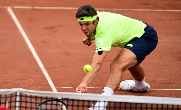 Jiri Vesely chases down a dropshot (Photo: Attila Kisbenedek/Getty Images)