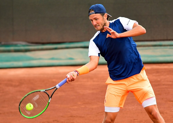 Lucas Pouille strikes a forehand shot (Photo: Attila Kisbenedek/Getty Images)