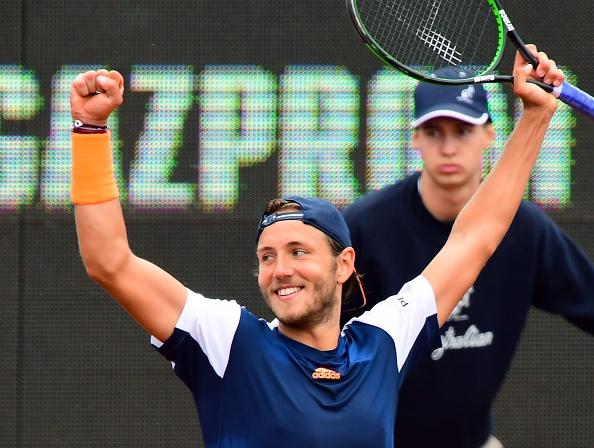 Lucas Pouille celebrates defeating Aljaz Bedene (Photo: Attila Kisbenedek/Getty Images)