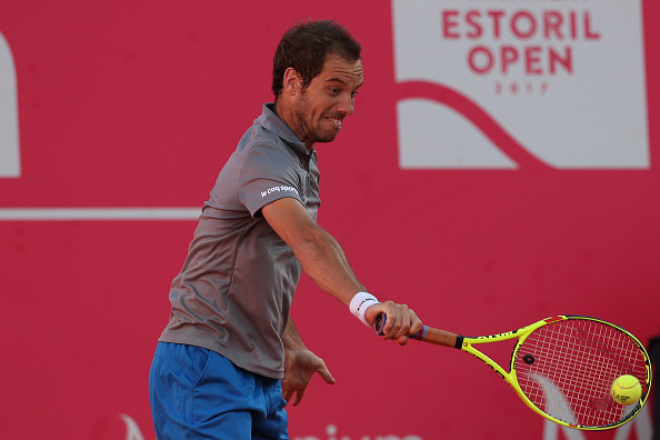Richard Gasquet plays a backhand shot (Photo: Carlos Rodrigues/Getty Images)