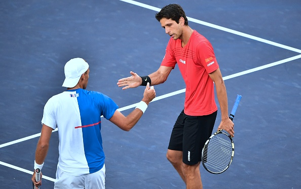 Lukasz Kubot and Marcelo Melo celebrate winning a point (Photo: Frederic J. Brown/Getty Images)