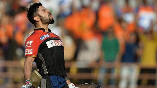 Kohli celebrates getting to his maiden T20 hundred | Photo: AFP