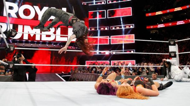 Lita execute her famous moonsault on Sasha Banks and Becky Lynch  Photo credit: WWE