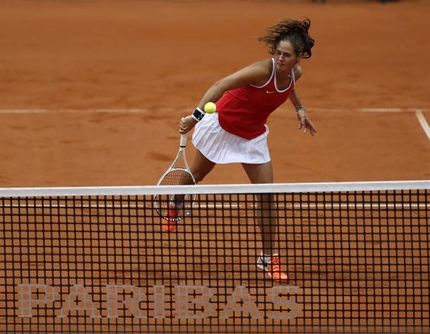 Daria Kasatkina hits a smash | Photo: Andrei Golovanov/Sergei Kivrin/Fed Cup