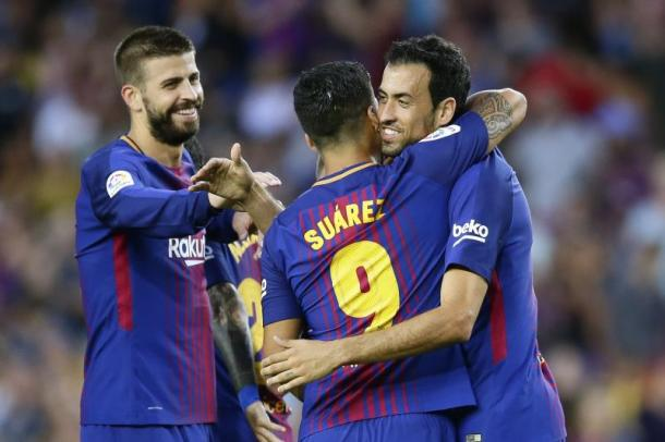 Piquè. Suarez e Busquets. Fonte: Manu Fernandez/Associated Press