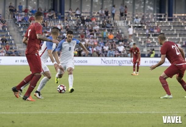 Clint Dempsey (8) and Bobby Wood look to move past Bolivian defenders Nelson Cabrera (5) and Ronald Eguino (21)  | Sven White - VAVEL USA