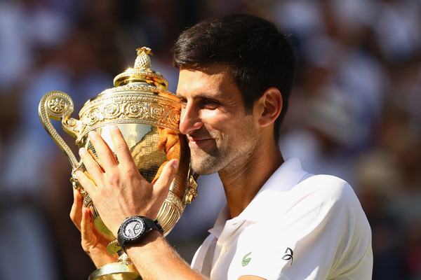 Novak Djokovic poses with the Wimbledon trophy last month. Photo: Michael Steele/Getty Images