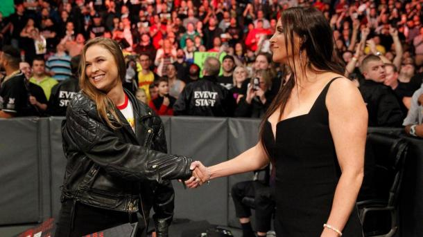 Stephanie McMahon was hesitant to accept the hand of the woman who nearly put her in an armbar.   Photo credit: WWE