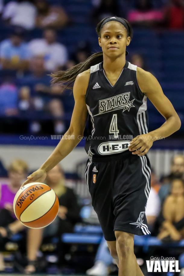 San Antonio's #4 Moriah Jefferson advances the ball during WNBA game between Chicago Sky - San Antonio Stars