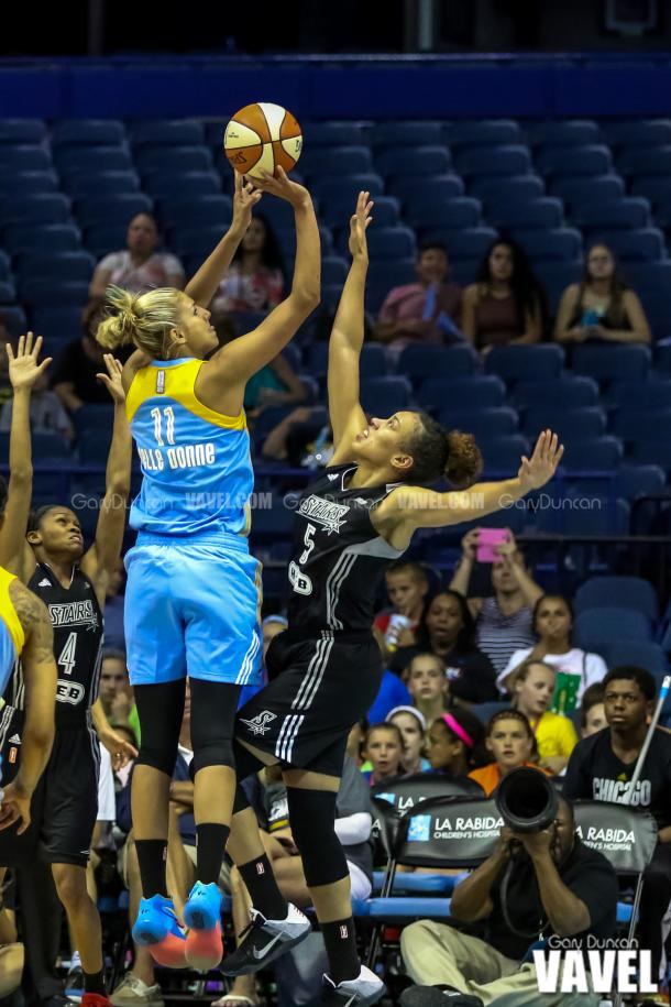 Chicago Sky's #11 Elena Delle Donne shoots over San Antonio's #1 Monique Currie during WNBA game between Chicago Sky - San Antonio Stars