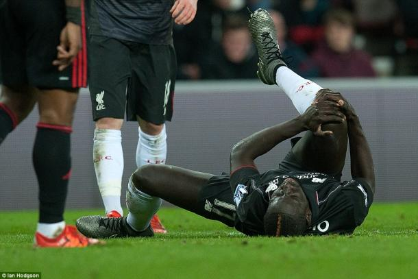 Mamadou Sakho was both unimpressed and in sufficient pain after Jeremain Lens' challenge.