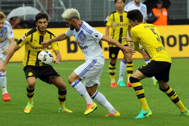 Both sides have faced a tough test in pre-season against Borussia Dortmund. (Image Source: The Chronicle)