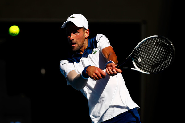 Novak Djokovic hits a backhand during his return in Melbourne. Photo: Michael Dodge/Getty Images