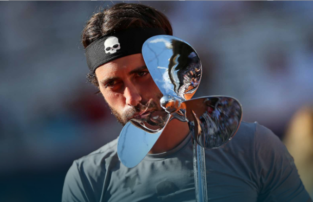 Nikoloz Basilashvili kisses the first trophy of his career in Hamburg. Photo: Cathrin Mueller/Bongarts/Getty Images