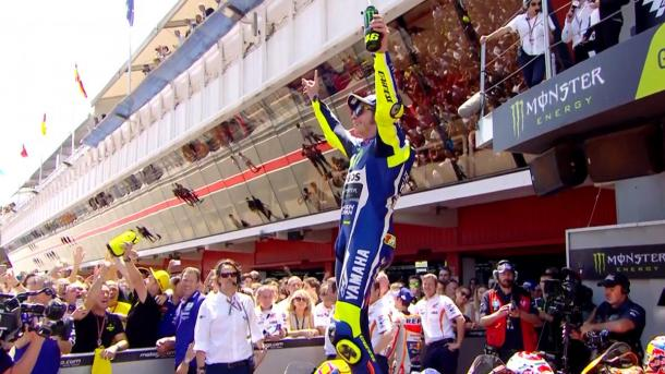 Rossi celebrating his win after battle with Marquez - www.motogp.com