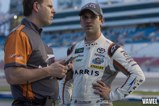 Daniel Suarez consults with his crew chief.