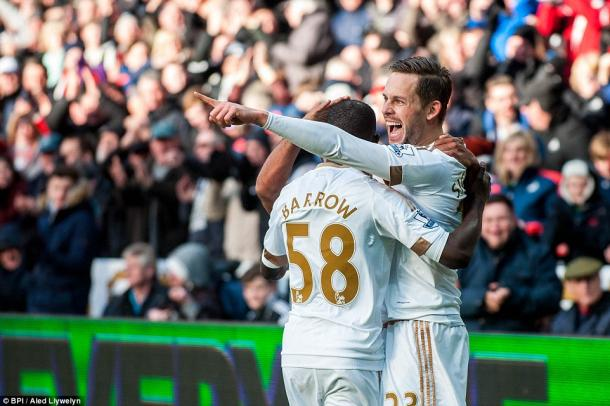 Super sub Barrow celebrates with goal-scorer Sigurdsson.   Photo: BPI