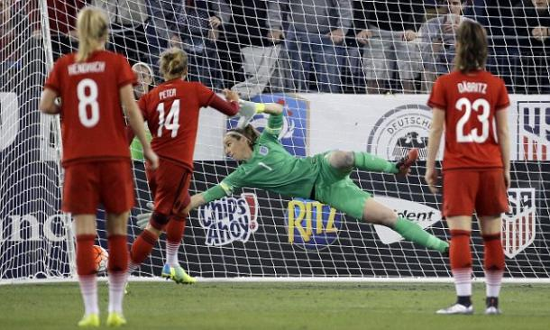 German defender Babett Peter converting the game winning penalty against England on Sunday. Photo provided by AP.