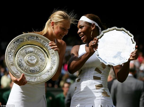 Maria Sharapova and Serena Williams have a chat while posing with their respective trophies after the 2004 Wimbledon final. Since then, Serena has gone 18-1 against Sharapova, with her only loss to the Russian coming at the year-end championships of that same year. | Photo courtesy of Getty Images