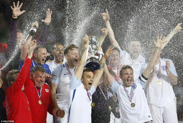 England's team celebrate their 3-2 win over the Rest of the World. (Photo: Reuters)