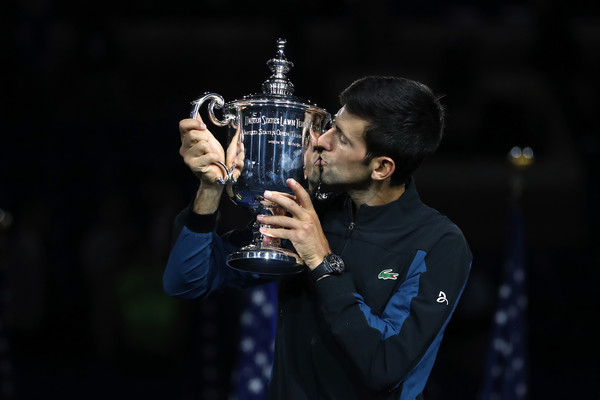 Novak Djokovic kisses his third US Open trophy on Sunday. Photo: Matthew Stockman/Getty Images
