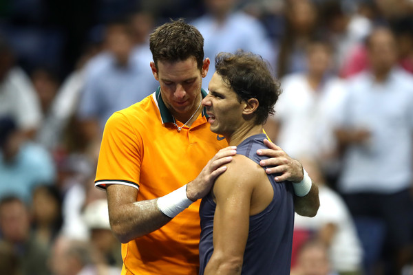 Rafael Nadal (right) is embraced by Juan Martin del Potro after the defending champion retired from their semifinal match. Photo: Julian Finney/Getty Images