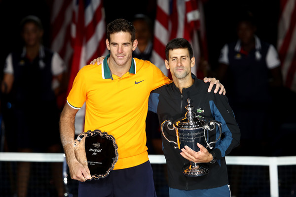 Del Potro (left) and Djokovic embrace with their trophies after the US Open final. Photo: Julian Finney/Getty Images