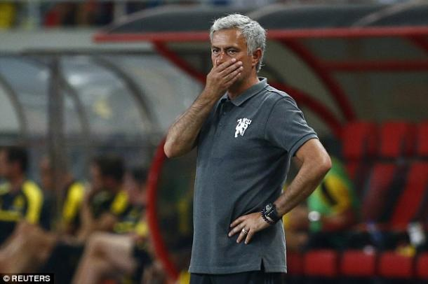 Above: Jose Mourinho watching his Manchester United side defeated 4-1 by Borussia Dortmund | Photo: Reuters