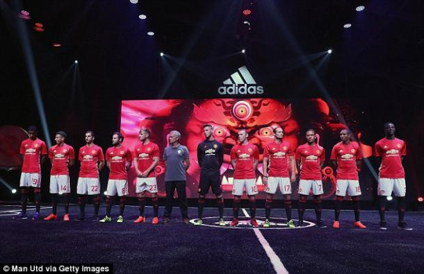 United players and manager Jose Mourinho line up in their kit unveiling (