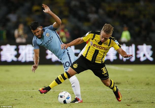 Above: Sergio Aguero battling with  Felix Passlack in Manchester City's 1-1 draw with Borussia Dortmund | Photo: Reuters