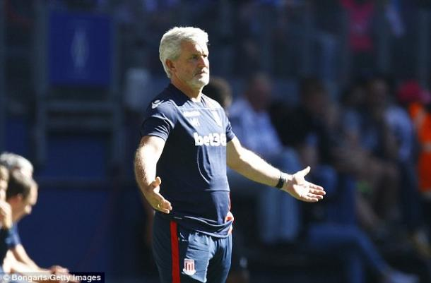 Above: Mark Hughes on the Stoke City touchline | Photo: Bongarts/Getty Images