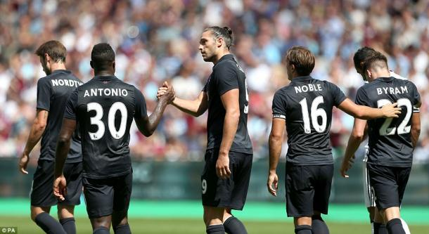 Andy Carroll celebrating his goal in West Ham's 3-2 defeat to Juventus. | Photo: PA