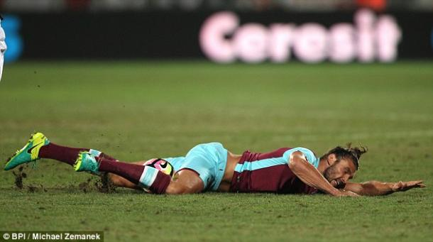 Above: Andy Carroll lying on the pitch after picking up an injury in West Ham's 1-1 draw with Astra Giurgiu | Photo: BPI/Michael Zemanek
