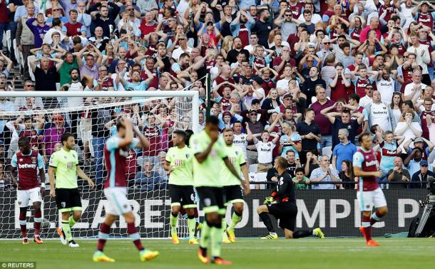 Above: West Ham fans reacting to Gokhan Tore's near miss during their 1-0 win over Bournemouth | Photo: Reuters