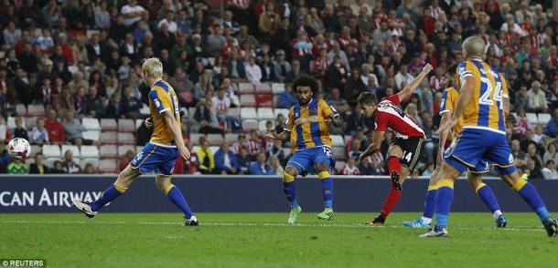 Above: Adnan Januzaj striking home his winning goal in Sunderland's 1-0 win over Shrewsbury Town | Photo: Reuters