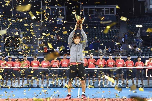 Yoshihito Nishioka hoists his maiden trophy in Shenzhen. Photo: Shenzhen Open