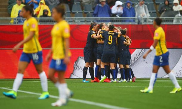 Australia celebrate their slender win over Brazil at last summer's World Cup. (Photo: Clive Rose/FIFA via Getty Images)